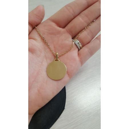 Médaillon rond en or 18k avec diamant